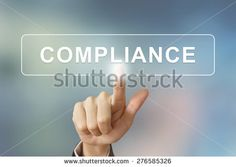 business hand pushing compliance button on blurred background - stock photo