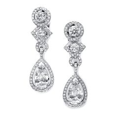 These sophisticated clip-on earrings feature a genuine Cubic Zirconia pear drop and inlaid stones. These stylish drop clip earrings are great for weddings, special occasions, black tie affairs or a ni
