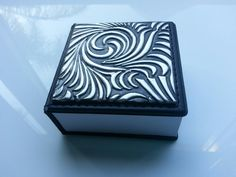 Leather note book with pewter embossed cover by Pewter Studio