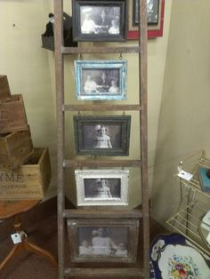 Rustic decor...Old ladder to display photos
