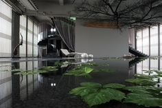 JinR created a revolutionary reimagining of a Tang dynasty emperor's bathhouse. Inside the Green T. House four-bedroom vacation villa and day spa is a large bath recessed into the slate floor filled with green tea–infused mineral water (shown), along with spoon-shaped tubs for hot-steam baths