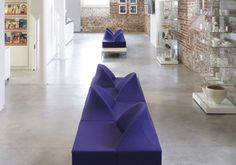 Violet rectangular couches with individual seating pockets