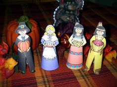 Get these darling paper dolls free to make for Thanksgiving. Ideal craft for children.