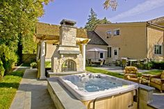 Hot tub and outdoor fireplace. Glenview Residence - eclectic - landscape - chicago - by Romani Landscape Architecture
