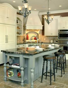 Kitchen island is cool in gray and the perfect contrasting color - Champlain Luxury Home Kitchen Photo from houseplansandmore.com