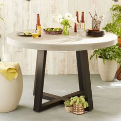 Crafted from lava stone atop an iron base, the Slab Round Dining Table's hand polished, versatile surface is equally at home indoors or outdoors. Its simple design and durable frame make it the perfect piece to gather 'round any time of year.