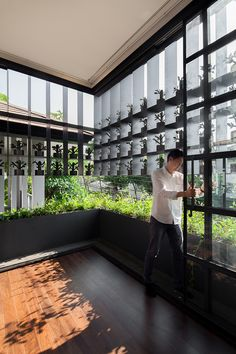 anonym studio turns old property into a flower cage house