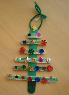 Kids' Christmas Crafts - Popsicle Stick Christmas Tree - iVillage Find other projects also! Stick Christmas Tree, Preschool Christmas, Christmas Crafts For Kids, Christmas Activities, Simple Christmas, Kids Christmas, Holiday Crafts, Christmas Ornaments, Christmas Decorations