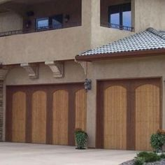 Custom two-toned wood garage doors make an elegant statement. | Wayne Dalton