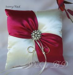 Wedding ring bearer pillow, Ivory with a red sash ring pillow, Red ring bearer pillow, Ivory ring pillow, Wedding ring pillowWedding ring bearer pillow and flower girl by duboisbridaldesigns rings ringsandringsIdeas for wedding rings box redGift Ideas Any Bow Pillows, Ring Pillows, Ring Pillow Wedding, Wedding Pillows, Sewing Crafts, Sewing Projects, Pillow Crafts, Ring Bearer Pillows, Ribbon Embroidery