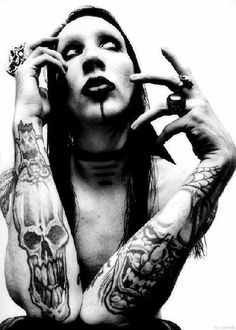 Marilyn Manson!!! I really cant explain why but if I could just have one night. I know something is wrong with me. I really don't why at all.