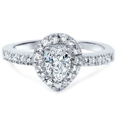 This popular engagement ring features one pear shape natural diamond. Round brilliant cut natural diamonds encircle the center stone and go half way down the shank. All diamonds are set in white gold. Celtic Engagement Rings, Popular Engagement Rings, Pear Shaped Engagement Rings, Halo Diamond Engagement Ring, Pear Shaped Diamond Ring, Diamond Rings, Natural Diamonds, White Diamonds, White Gold Rings