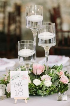 Elegant #wedding #centerpiece idea - greenery wreath with pink roses and floating candles {Query Events}