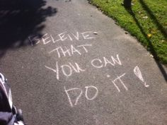 Inspirtational words written in sidewalk chalk along running route (use stakes with signs for grass routes)