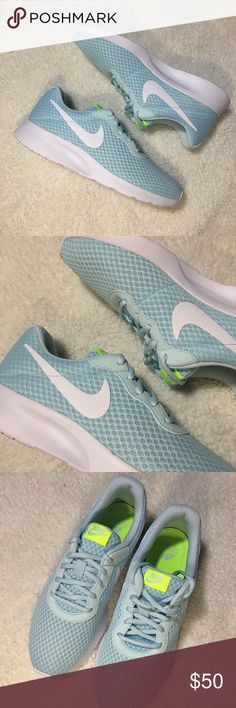 Woman's Nike Tanjun Brand new without the box. Baby blue color Nike Shoes Athletic Shoes