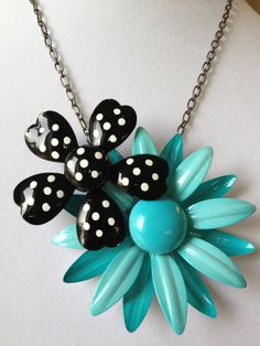 Upcycled vintage brooch necklace, enamel flower necklace, statement necklace, reclaimed vintage, bib necklace, turquoise daisy,. $45.00, via Etsy.