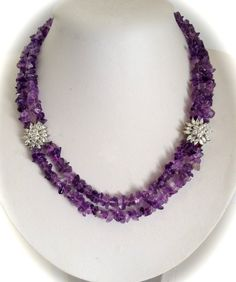 Organically shaped Strands of Shimmery Violet Amethyst Beads Juxtaposed with Sparkling Diamonds Is a Uniquely Elegant and Chic Combination
