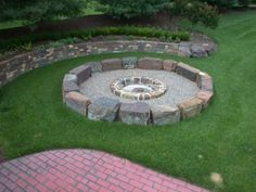 pretty retaining wall & fire pit. I like this idea, cheap to buy rocks? Hay bales?