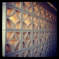 Inspired by mid century concrete ty pennington home for Besser block home designs
