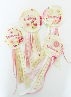 A set of 4 personalised handcrafted rosettes that make a unique alternative to hen party accessories. Available via www.boutiquetoyou.co.uk with FREE delivery.