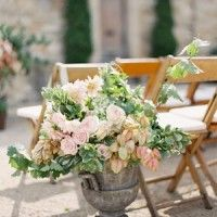 """Check out this """"earthy, romantic"""" wedding.  The flowers are beautiful, so is the decor."""