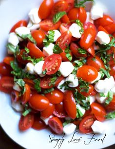 Caprese Salad. Okay I'm using this picture again and not the recipe. The one I had was at a restaurant I went to. It was ripe cherry tomatoes, fresh shredded basil, fresh mozzarella balls, sweet balsamic vinaigrette and a bit of fresh ground pepper.