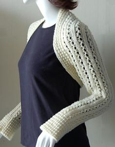 """FREE PTRN. SEE LINK: 'Lace Rib Knit Shrug' Crystal Palace Yarns Merino 5 Superwash Solid, Worsted / 10 ply (9 wpi) 50g/110yds. Sz: S (M, L, XL)  6 (7, 8, 9) 50 gr. Balls;  #5204 """"natural"""" Gauge: 18 sts and 28 rows = 4 inches in Double Lace Rib pattern using Size 8 needles, blocked and slightly stretch to open pattern. GAUGE: 26 sts and 35 rows =4"""" in Ridged Rib using size 6 needles. US Size 6 (4mm), 7 (4.5mm) and 8 (5 mm) 14"""" straight and US Size 6 (4mm) 35"""" circular needle."""