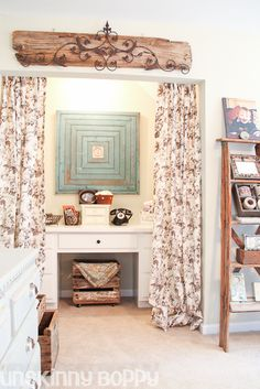 desk nook with blue beadboard wall hanging and an old ladder for a shelf.