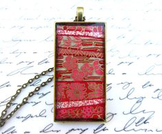 Pink & gold chiyogami necklace, $15 on Etsy