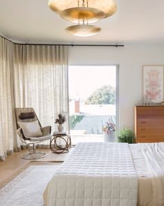 Wraparound Ripple Fold Drapery is perfect for soaking in the view or enjoying a little R&R. Get the look at theshadestore.com // Design by Natalie Myers // Photo by Charlotte Lea Photography Bedroom Windows, Design Consultant, Beautiful Bedrooms, Drapery, Window Treatments, Blinds, Swatch, Chair, Wraparound