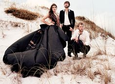 Lady Antebellum Downtown- this image uses leading lines with the black dress leading up to the subjects of the singers. They are all off center using the rule of thirds and there are different heights to the picture that the are on a hill and each of the singers are at different levels.
