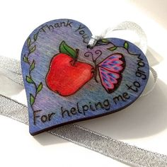 A lovely teacher, tutor or childminder gift. A birch ply heart with my own design burned into the front, then coloured with acrylic paint, prismacolor pencil and posca inks, then varnished to protect it. Teacher Cards, Teacher Gifts, Thank You Plaques, Birch Ply, Woodburning, Pinterest Blog, Prismacolor, Red Apple, Pyrography