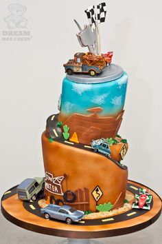 side view of cars themed cake