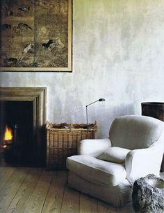 """Cozy and warm contrasts with """"worn"""" and cool plaster wall finish."""