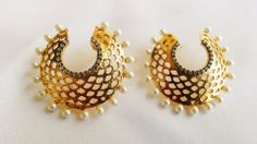 Classic Chand Bali With Pearls  http://www.curiotown.com/Jewelry/Earrings/classic-chand-bali-with-pearls   Classic chand bali earrings embellished with faceted stones. Multiple pearl drops completes this piece. Glam up your outfit at the next occasion with this stunning pair of earrings.  Price :1300/- Product Code:CT/AP/N19  Available: @Wendy Werley-Williams.curiotown.com