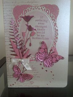 Handmade card using Memory box dies in pink with butterflies and flowers by Dolores Collins