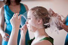 DIY birdcage veil. I basically bought a bunch of netting and feathers on Etsy then went nuts with my glue gun. Lo' and behold- bird cage veil with fascinator! Not perfect but worked great with enough bobby pins! (Photo by Robert Rios)
