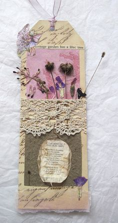 Garden of Dried Flowers on a Tag. This is similar to what I plan on making sometime soon. I love the delicate, vintage, shabby chic look of these. And I'm a sucker for multimedia art. Also I'm just really tired of using random pieces of paper, receipts, napkins, business cards, etc. as bookmarks. (: