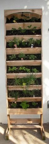 Alternate wooden vertical garden option to the pallet design.