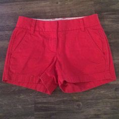 Jcrew khaki shorts Red khaki shorts. The picture showing the back of the shorts shows only one button but that is how they were made, no button is missing! J. Crew Shorts