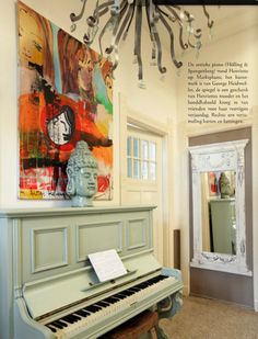 my husband wants to perhaps get an upright piano....I can imagine one painted glossy white like this....love the buddha head too!