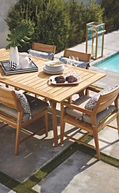 Modern lines pair with classic teak construction for relaxed yet sophisticated outdoor dining. | Frontgate: Live Beautifully Outdoors