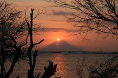 The Colours of Bali: Sunset over Gunung Agung, as seen from the west coast of Gili Trawangan #thegilibeachresort www.thegilibeachresort.com