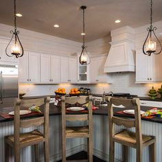 The kitchen of the All-American Cottage features Monterey style maple cabinets in Glacier Pewter Finish by Wellborn Cabinets, proud crafters of custom cabinetry in the USA since 1961.