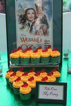 """Wizard of Oz partial tablescape. Love the Emerald City table cloth & movie art backdrop. I especially love the """"Take one my pretties"""" sign! Wizard Of Oz Play, Wizard Of Oz Decor, Kids Party Themes, Birthday Party Themes, Party Ideas, Emerald City Party, 40th Birthday, Girl Birthday, Whimsical Halloween"""