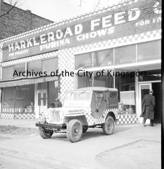 Exterior of the Harkleroad Feed Company. Harkleroad Feed Company was located at 124 E. Market and was owned by Mrs. Margaret D. and Robert H. Harkleroad. The store sold feeds, seeds, insecticides, farm machinery, fertilizers, bee and poultry supplies, garden tools, and freezers.