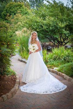 Beautiful Kaley! Fall wedding at Lake Lanier islands. #lakelanierislands,  #fallwedding. #outdoorwedding.   #Bridalbouquet of #ivoryroses, #whitehydrangeas, #gardenias.