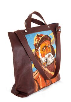 """""""Dorus"""" Dark brown leather shopper or tote with vintage cross-stitch embroidery of a fishermen. Designed and made by Dutch designer Anna Treurniet. annatreurniet.nl"""