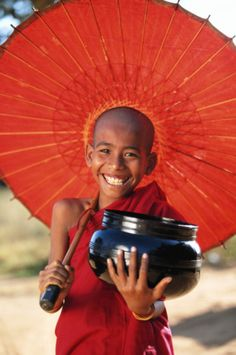 novice with parasol and begging bowl in Burma