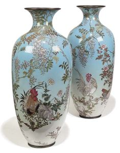 A PAIR OF JAPANESE CLOISONNE ENAMEL BALUSTER VASES  LATE 19TH CENTURY  Of large scale, painted with cockerel and hen, surrounded by stylised flowers on a sky-blue ground. Christie's.